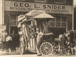 Receiving a shipment of bicycles, Geo. L. Snider - Bicycles-Motorcycles-Phonographs