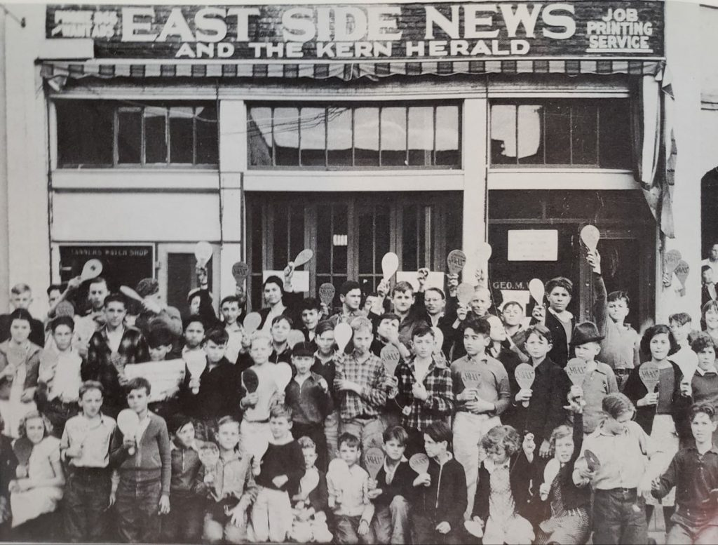 "The East Side News ""Newsies"" pose in front of the office on Baker Street with their new Hi-Li (Jai Alai) paddles in the mid 1930s."