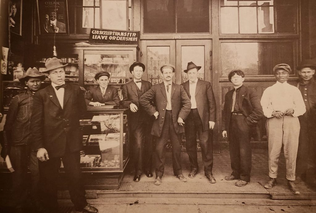 Patrons pose outside the Leader Saloon on the south side of Sumner near Baker. This building is still standing although it bears little resemblance to this shot from 1910.