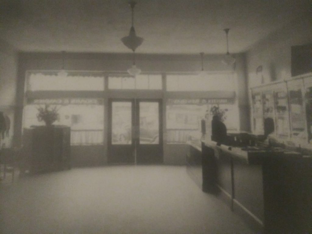 PHOTOGRAPH SHOWS THE FRONT OF THE HASTIN AND WESTBAY CIGAR AND CANDY STORE AT 960 BAKER STREET-1925 BAKERSFIELD CA