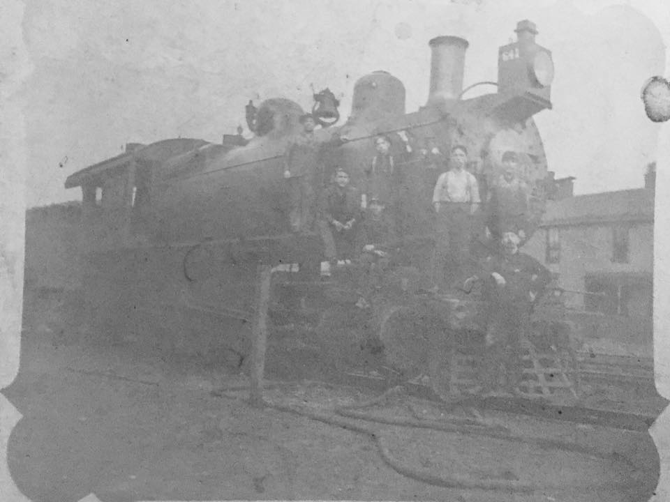 Bakersfield Southern Pacific RR roundhouse circa 1910. In the photo are both Larry Barton's Great Grandfathers. Samuel A. Barton, on the front in the white shirt and suspenders and Joseph L. Finn standing on his right in the dark shirt and suspenders. Both were long time Kern County residents.