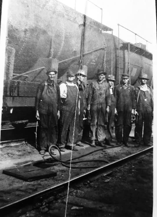 Second from the right is Larry Barton's Great Grandfather Samuel A. Barton ( a long time Kern Co. resident) with his fellow Southern Pacific Carmen( Car Knockers). Bakersfield CA 1913. They are holding packing irons and shoe bars. The hose is for filling journal boxes with oil.