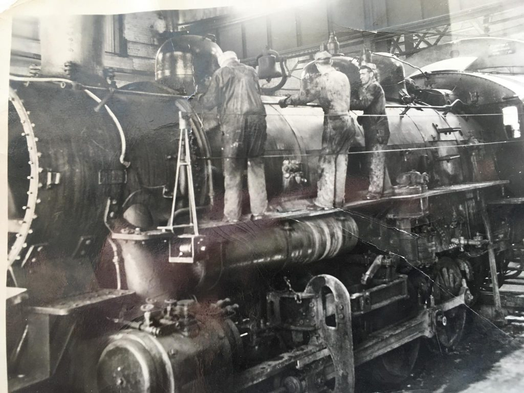 This picture was taken in the summer of 1943. This steam locomotive was in the round house at the Southern Pacific RR shop on Kentucky street. The man on the right is my father Doyle Cravens. He was a pipe fitter and worked for the Southern Pacific for 35 years. I don't know who the other two men are.