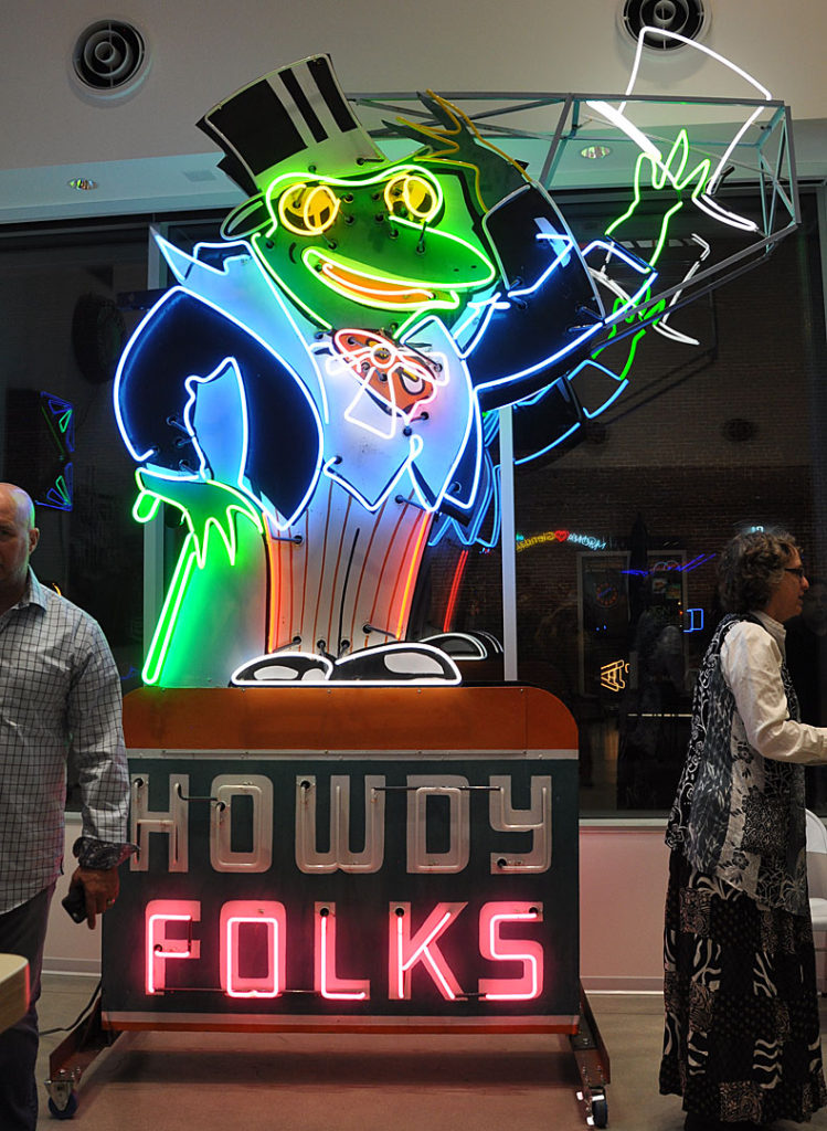 Green Frog Market neon sign