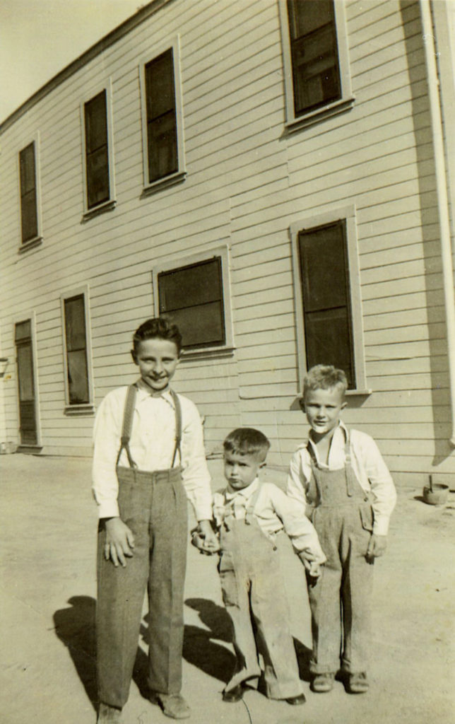 Albert Elizalde, George Ansolabehere and Louie Elizalde on the west side of the Noriega Hotel where the dining room is located. Circa 1933 Californian file photo